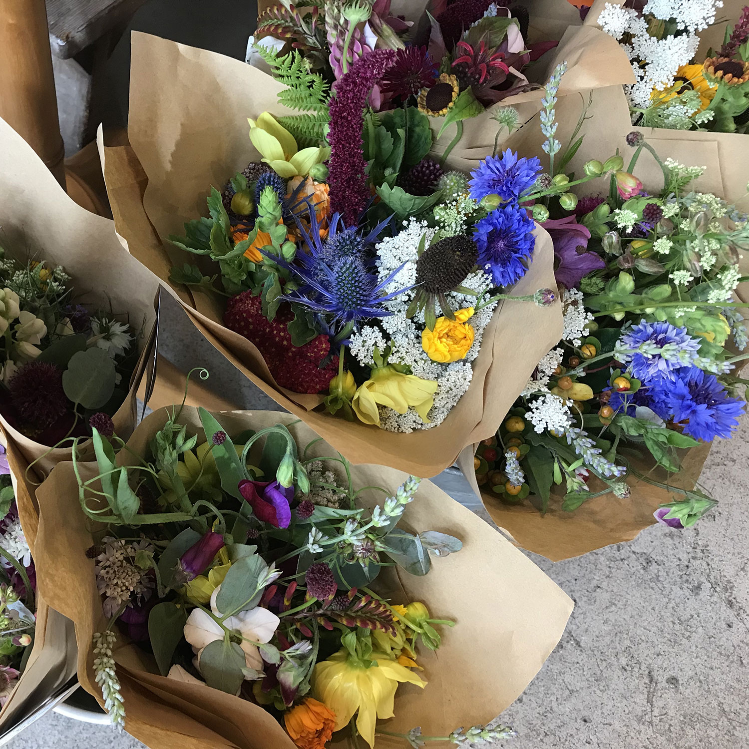 During the summer we regularly have fresh local flowers in stock.